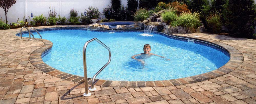 photo of a Residential Pool with a boy swimming