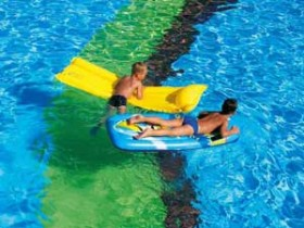 2 Boys floating on rafts in pool photo