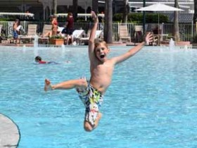 Happy Boy Jumping in Pool photo