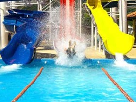 person making splash on water slide